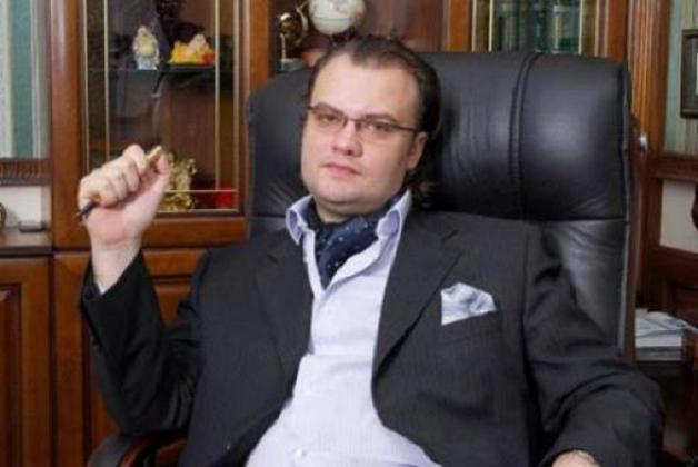В Киеве арестовали землю, оружие, счета и семь авто известного банкира