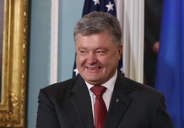 Порошенко владеет акциями банка Путина